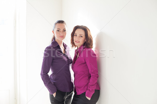 два девочек Purple стен белый девушки Сток-фото © dmitriisimakov