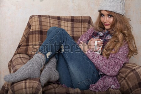 a girl sits in a chair with cup of coffee or tea Stock photo © dmitriisimakov