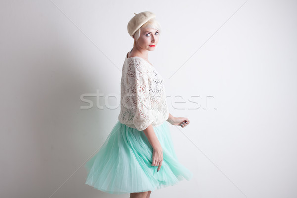 Stock photo: Portrait of a woman in a beret and bright clothes