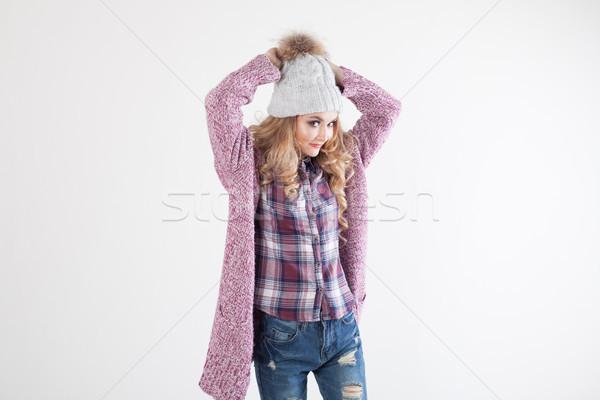 девушки Hat свитер позируют белый комнату Сток-фото © dmitriisimakov