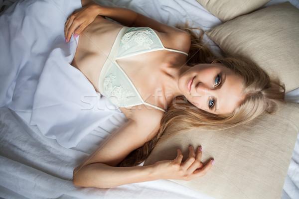 the girl woke up in the morning in the bedroom in white bed Stock photo © dmitriisimakov