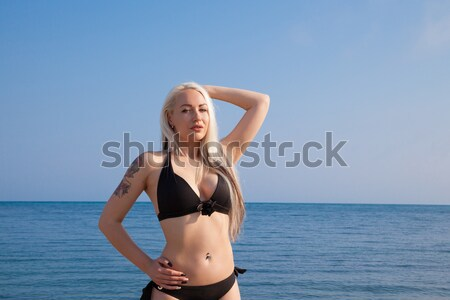 girl in bathing suit sunning at the beach is worth by the sea Stock photo © dmitriisimakov