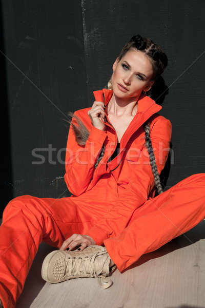 woman with colorful braids in working clothes Stock photo © dmitriisimakov