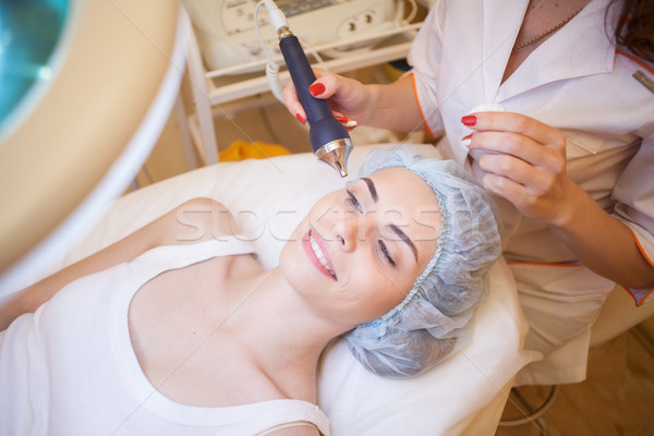 Cosmetology doctor makes the procedure a woman face cleaning Stock photo © dmitriisimakov