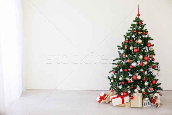 Christmas tree with red gifts in the white room Christmas Stock photo © dmitriisimakov
