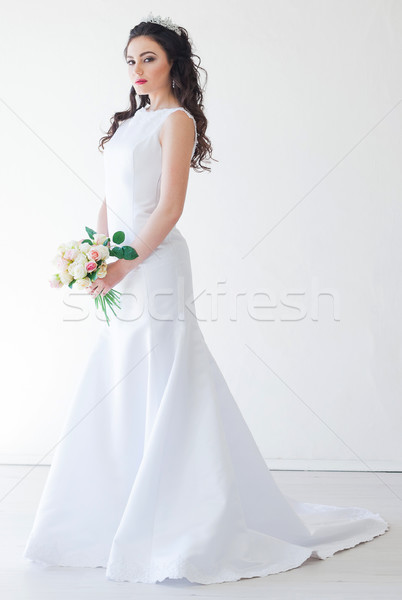 bride in white wedding dress with a bouquet of flowers Stock photo © dmitriisimakov