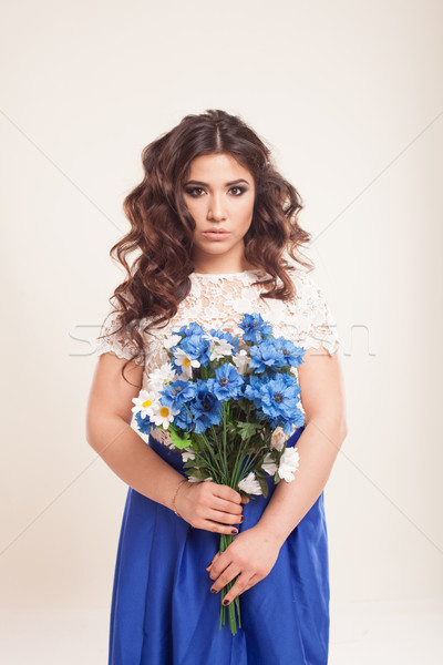 girl in a dress with blue flowers in hands Stock photo © dmitriisimakov