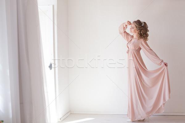 girl in lingerie Pajamas pink Stock photo © dmitriisimakov