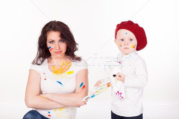 mother and little boy paints when painted Stock photo © dmitriisimakov