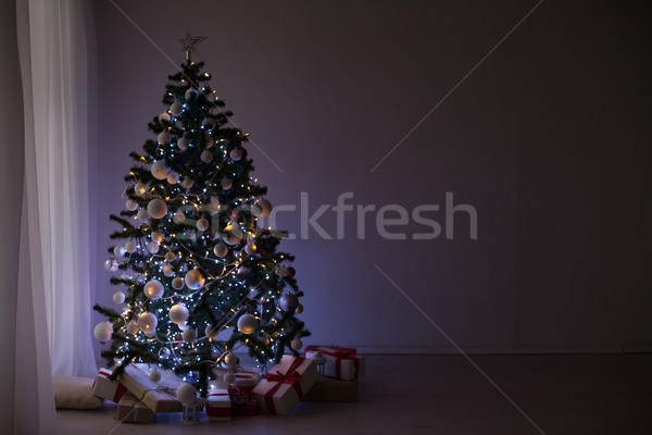 garlands of lights on a Christmas tree for Christmas Decor Stock photo © dmitriisimakov