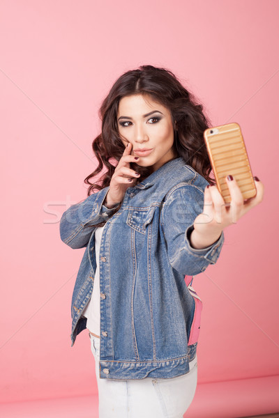 beautiful girl posing and photographing himself Stock photo © dmitriisimakov