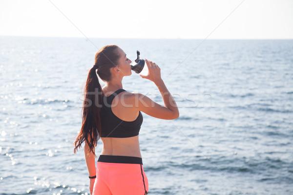 Fitness girl drinks water sport training Stock photo © dmitriisimakov