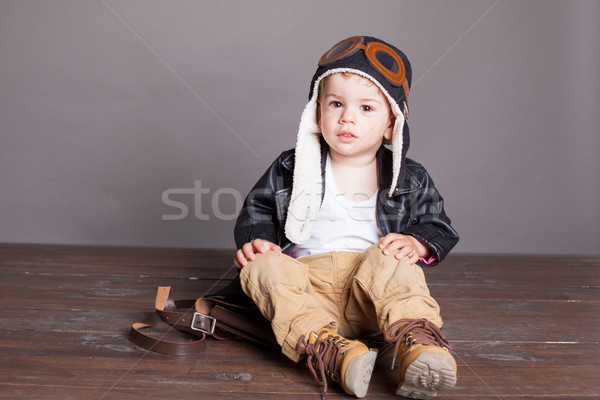 little boy pilot plays in airplanes Stock photo © dmitriisimakov