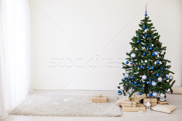 Christmas tree with blue in a white room with toys for Christmas Stock photo © dmitriisimakov
