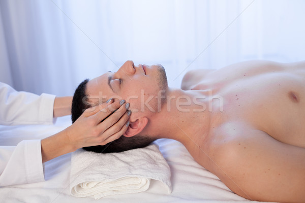 masseuse makes a therapeutic massage of the head and neck man Spa Stock photo © dmitriisimakov