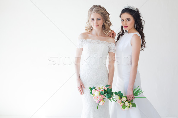 Kettő menyasszonyok fehér esküvő nő virág Stock fotó © dmitriisimakov