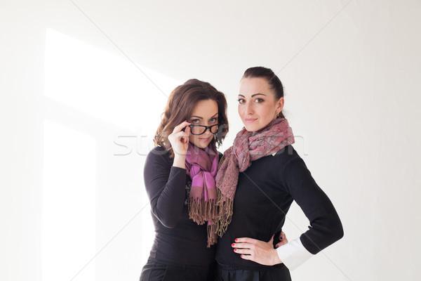 two girls cuddling a laughing glasses Stock photo © dmitriisimakov
