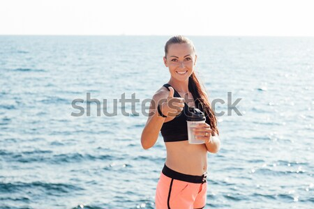 beautiful girl in a bathing suit sunning on the beach Stock photo © dmitriisimakov