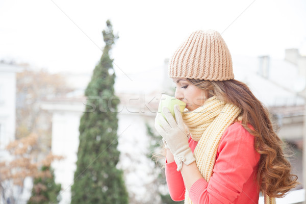 the girl in the hat froze and drinking hot tea Stock photo © dmitriisimakov