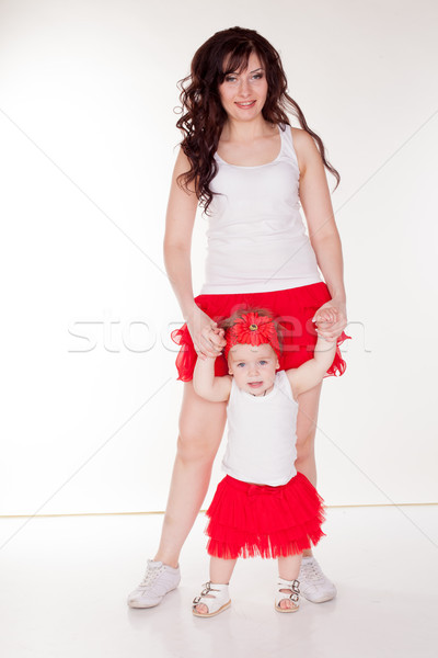 mother and little daughter in red skirts Stock photo © dmitriisimakov