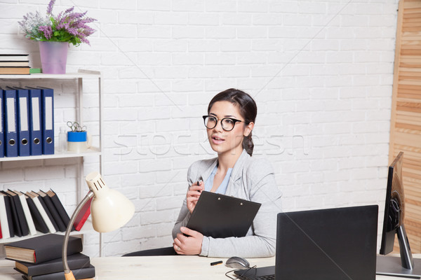 Stock photo: the business Secretary girl works at the computer