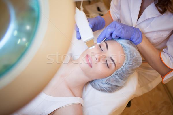doctor cosmetologist doing facial massage girl Stock photo © dmitriisimakov