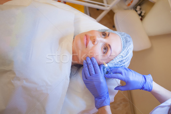 doctor beautician increases lip patient an injection syringe Stock photo © dmitriisimakov