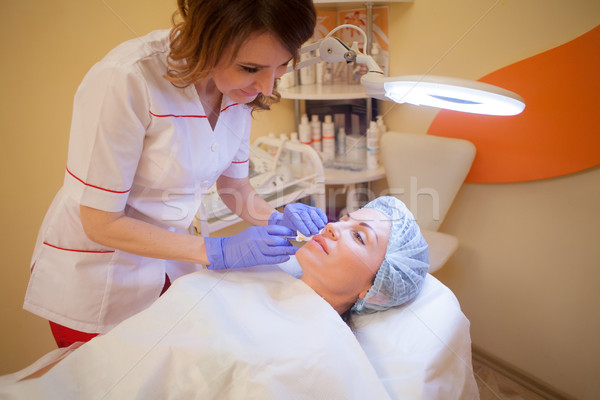 Stock photo: doctor cosmetologist makes injection syringe on the face