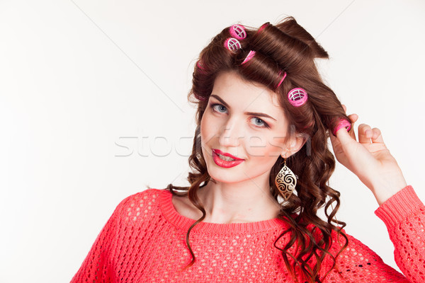 girl with curling irons makes hair style Stock photo © dmitriisimakov