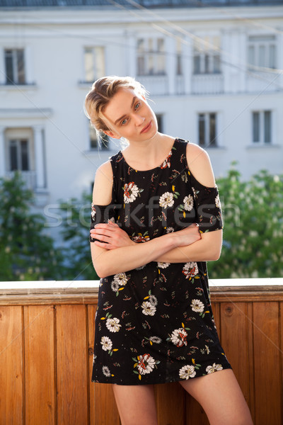 blonde girl in a dress with flowers on the background of the House Stock photo © dmitriisimakov