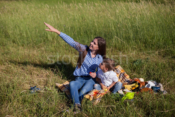 mother and little boy look up summer time Stock photo © dmitriisimakov