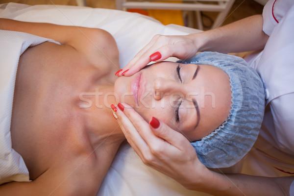 doctor cosmetologist doing facial massage girl spa Stock photo © dmitriisimakov