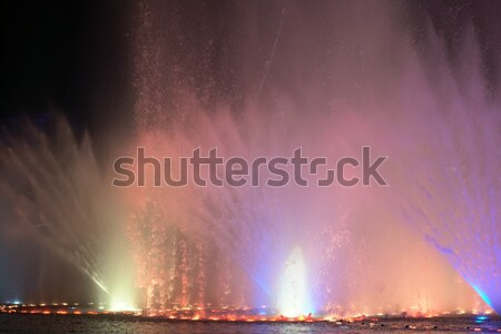 multi-coloured jets of water fountain illuminated lights Stock photo © dmitriisimakov