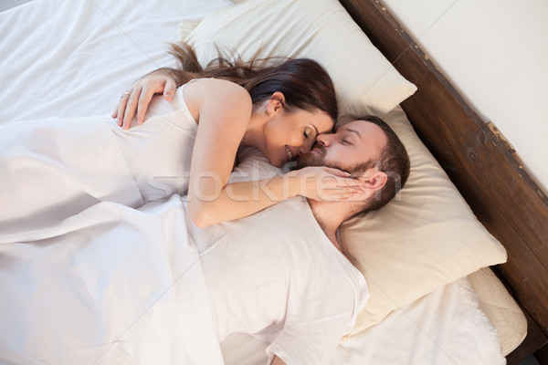 husband and wife are sleeping in beds with white linen Stock photo © dmitriisimakov