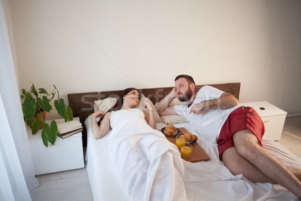 husband and wife woke up in the morning, breakfast in bed Stock photo © dmitriisimakov