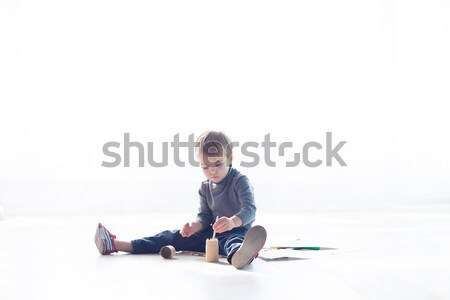 little boy paints a picture of crayons Stock photo © dmitriisimakov