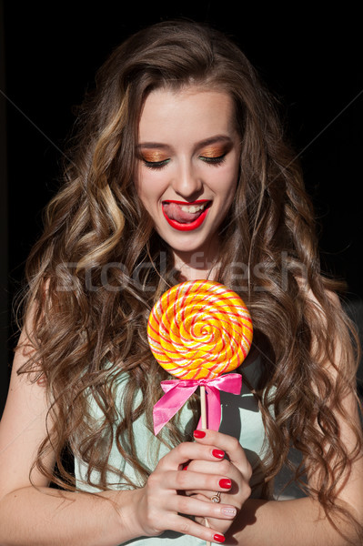 girl in colorful clothes eats colored lollipop tasty Stock photo © dmitriisimakov