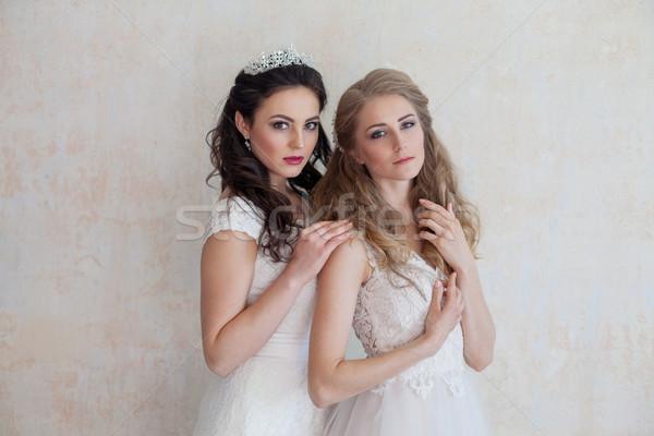 two girls in white dresses brunette and blonde Stock photo © dmitriisimakov