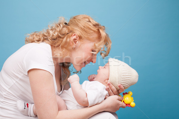 mom in white clothes with her son baby Stock photo © dmitriisimakov