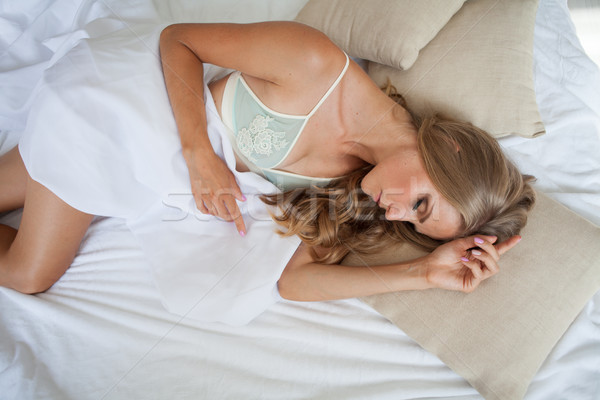 blonde girl sleeps in a bed in the bedroom, dreams sees Stock photo © dmitriisimakov