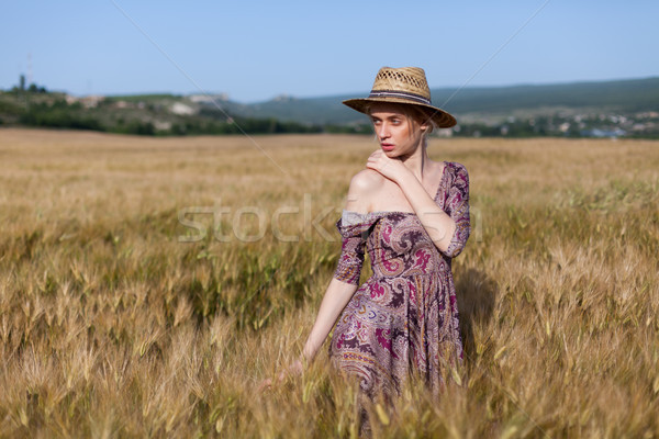 beautiful woman farmer in field of wheat farm Stock photo © dmitriisimakov