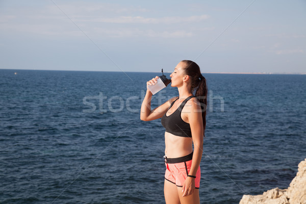 Fitness girl drinks water sport training Stock photo © dmitriisimakov