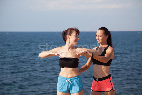 fitness trainer shows woman sport exercises Stock photo © dmitriisimakov