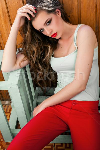 красивая женщина красочный одежды красный брюки сидят Сток-фото © dmitriisimakov