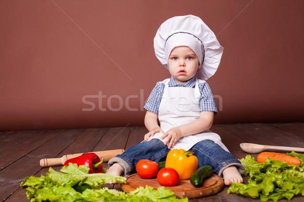 little boy Cook carrots, peppers, tomatoes, lettuce, Stock photo © dmitriisimakov