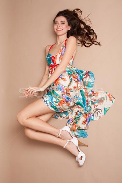 Dziewczyna kolorowy sukienka piętrze uśmiech beżowy Zdjęcia stock © dmitriisimakov