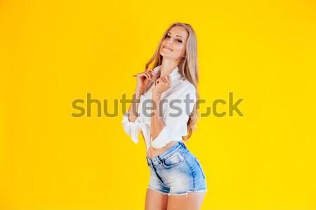 Sovány lány pózol citromsárga divat szőke nő Stock fotó © dmitriisimakov