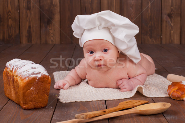 Baba szakács hazugságok asztal kenyér liszt Stock fotó © dmitriisimakov