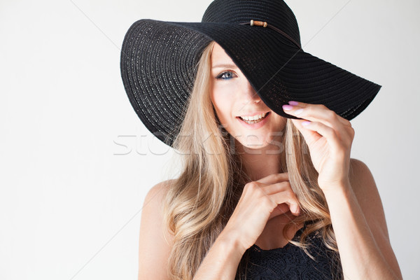 fashionable girl in a hat with a brim poses for advertising Stock photo © dmitriisimakov