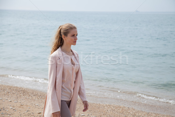 blonde girl walks along the beach of the sea coast Stock photo © dmitriisimakov